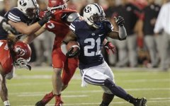 BYU running back Jamaal Williams (21) cuts through the Utah defense during the second quarter of the Saturday, Sept. 15, 2012 game in Salt Lake City. A new pair of games will be played in 2017 and 2018. (AP Photo/Rick Bowmer)