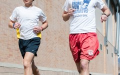 Alexander Lew, left runs in minimalist shoes. Chris Holdaway, right, runs in five-finger shoes. (Photo by Chris Bunker)