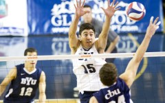 Taylor Sander attempts a block in a match earlier this season. (Photo by Sarah Hill)