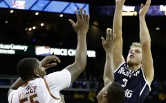 Tyler Haws gets past two Texas defenders to put up a shot during the second half of the game. BYU won 86-82. Photo courtesy AP Photo/Charlie Riedel.