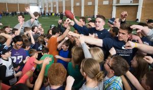 Sixth graders interact with BYU athletes at the annual Sports Hero Day.
