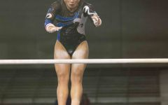 Raquel Willman Hatch competes on the bars in the meet against Utah State