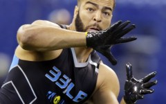 BYU linebacker Kyle Van Noy makes a catch as he runs a drill at the NFL football scouting combine in Indianapolis. (AP Photo/Michael Conroy)