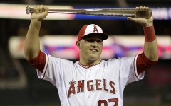 American League pitcher Mike Trout, of the Los Angeles Angels, holds the MVP trophy after his team's 5-3 victory over the National League in the MLB All-Star baseball game, Tuesday, July 15, 2014, in Minneapolis. (AP Photo/Jeff Roberson)