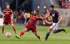 Kyle Beckerman, who returned on Thursday from the World Cup in Brazil, beats Revolution forward Patrick Mullins to the ball. (Ari Davis)