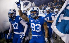 The BYU football team enters the field before the game against Utah State (Universe Photo