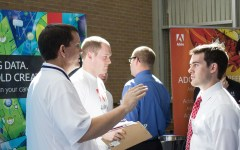 Student speaks with Adobe Representative