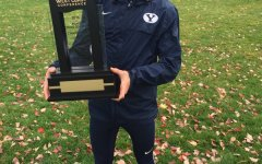 Team Captain Dylan Shawn holds the WCC Championship trophy.  The men's cross country team had seven runners in the top eight. (BYU T&F/CC Twitter account)