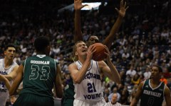 Junior-transfer Kyle Davis comes down with a rebound against UVU. Davis had 17 points and 20 rebounds. (Maddi Driggs)