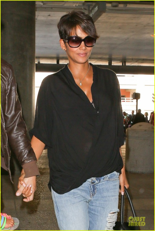 Oh look, it's Halle Berry in a simple blouse, ripped jeans and sunglasses. Easy!