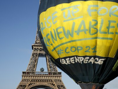 Greenpeace activists fly a hot air balloon depicting the globe next to the Eiffel Tower ahead of the 2015 Paris Climate Conference COP21