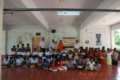 Swami Aksharatmanandaji Maharaj with children. Dr PSS Murthy, our president and Dr. TGK Murthy are also seen