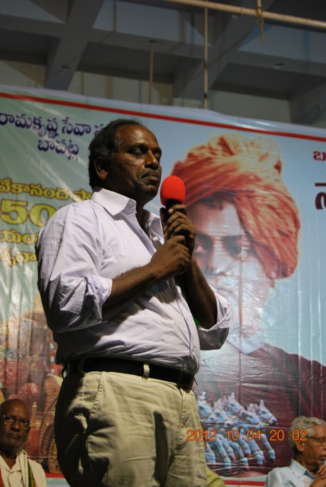 Sri Gopalam Ravindra Babu speaking in the meeting on the message of Swamijil