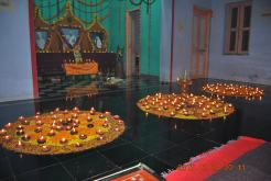 Evening: lighting lamps by devotees