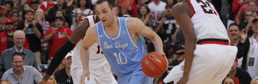Ian Lituchy/The USD Vista Duda Sanadze, USD senior, dribbles through SDSU players to lead the team to a win last weekend.