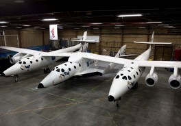 Photo: SpaceShipTwo under the Mothership WhiteKnight2 in Mojave, CA. Photo from Virgin Galactic/Mark Greenberg