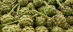 Stacked artichokes in a fruit and vegetable store.