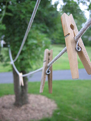 A clothes line with some pegs (clothespins) ne...