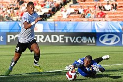Austrian Forward Rubin Okotie tries to score o...