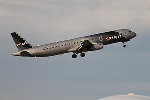 Spirit Airlines N587NK (an A321-231) lifting o...