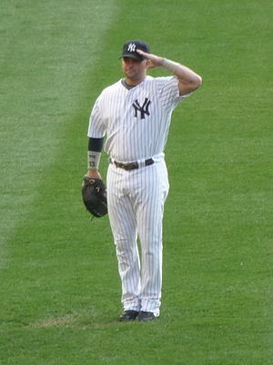 Nick Swisher salutes the crowd during roll cal...
