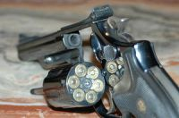 Smith&Wesson Model 19 and its cilinder open. F...