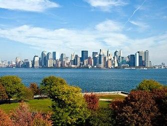 English: Skyline of New York City from Ellis I...