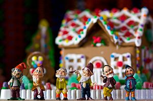 In front of a gingerbread house.