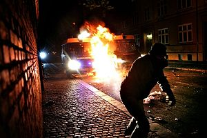 Protester throwing Molotov Cocktail at a polic...