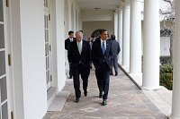 President Barack Obama walking with Vice Presi...