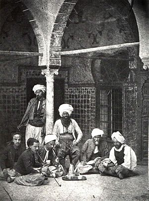 arab men smoking pipe and drinking turkish cof...