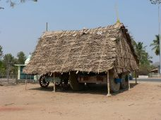 A roofing structure made from poles and palm l...