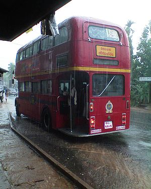A double-decker bus plying in the 122 route fr...