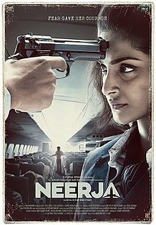 The poster depicts a scene inside a flight. A lady is seen with a gun imposed on her forehead by anonymous. In the background, a man holds a gun.