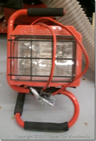 Halogen lamp, great as a raking light for finishing. $10.