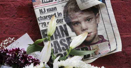 This May 28, 2012, file photo shows a newspaper with a photograph of Etan Patz at a makeshift memorial in the SoHo neighborhood of New York where Patz lived before his disappearance on May 25, 1979. (AP Photo/Mark Lennihan, File)