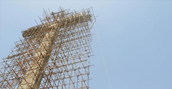 """A Christian businessman is building a 140-foot cross in the middle of Pakistan's largest city. The cross, expected to be completed this summer, is being billed as the """"largest cross in Asia."""" (Tim Craig/The Washington Post)"""