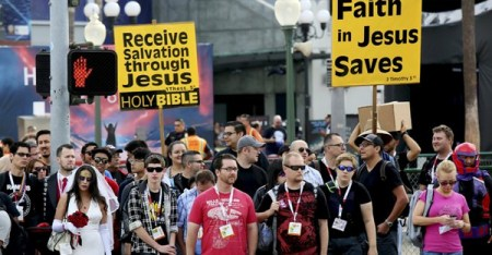 Picketers behind convention attendees at the 2015 Comic-Con International in San Diego last week. Entertainment fare with a religious bent drew scant attention. (Sandy Huffaker/Reuters)