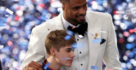 Singer Justin Bieber and NBA player Tyson Chandler stand onstage during The 2011 ESPY Awards at Nokia Theatre L.A. Live on July 13, 2011 in Los Angeles, California. (Christopher Polk/Getty Images North America)