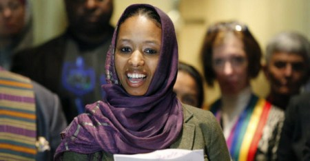 Wheaton College associate professor Larycia Hawkins talks to reporters during a news conference Wednesday in Chicago. Hawkins, a Christian teaching political science at the private evangelical school west of Chicago, was put on leave Tuesday. (Charles Rex Arbogast/AP Photo)