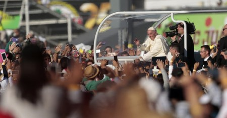 Pope Francis waves from the popemobile in Ciudad Juarez, Chihuahua state, Mexico on February 17, 2016. Throngs gathered at Mexico's border with the United States on Wednesday for a huge mass with Pope Francis highlighting the plight of migrants -- a hot-button issue on the US presidential campaign trail. (AFP)