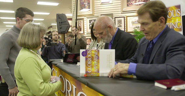 Tim LaHaye (right) and Jerry B. Jenkins sign the 12th book in the Left Behind series at a store in Spartanburg, S.C., in 2004. (Mary Ann Chastain/AP)