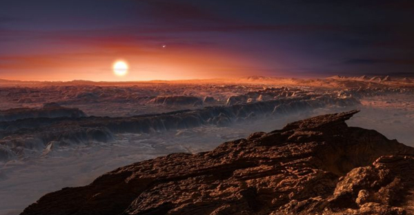 This artist's impression shows a view of the surface of the planet Proxima b orbiting the red dwarf star Proxima Centauri, the closest star to the Solar System. (ESO)
