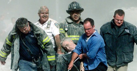 Rescue workers carry fatally injured New York City Fire Department chaplain, the Rev. Mychal Judge, from the wreckage of the World Trade Center in New York City on Sept. 11, 2001. (Photo courtesy of REUTERS/Shannon Stapleton)