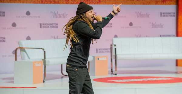 """Rapper Dee-1 performs """"Sallie Mae Back"""" at Washington Ideas Forum, where he also spoke about his financial literacy campaign with PricewaterhouseCoopers. (Courtesy of Max Taylor Photography)"""