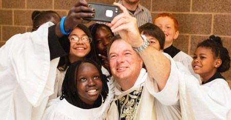 Bishop Gregory H. Rickel takes a selfie with the choir at St. Columba Church in Kent, Wash. (PHOTO: JENNY JIMENEZ)