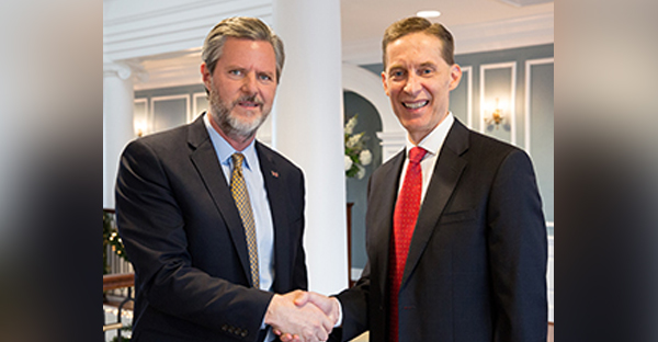Jerry Falwell Jr., left, president of Liberty University, shakes hands with Liberty's new athletic director Ian McCaw. (Courtesy of Liberty University)