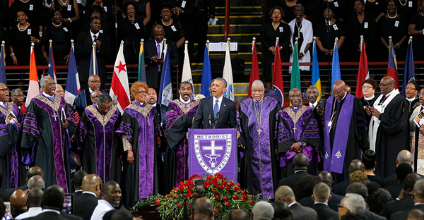 "U.S. President Barack Obama leads mourners in singing the song ""Amazing Grace"" as he delivers a eulogy in honor of the Rev. Clementa Pinckney during funeral services for Pinckney in Charleston, S.C., on June 26, 2015. Pinckney is one of nine victims of a mass shooting at the Emanuel African Methodist Episcopal Church. (Photo courtesy of Reuters/Brian Snyder)"