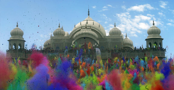 Revelers throw colored corn starch into the air as they celebrate the 2015 Holi (Festival of Colors) at the Krishna Hindu Temple in Spanish Fork, Utah, on March 28, 2015. (Rick Bowmer, Associated Press)