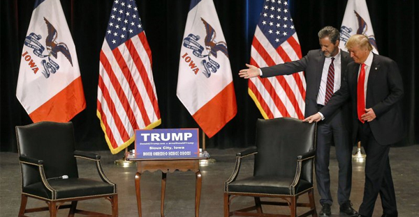 In this Sunday, Jan. 31, 2016 file photo, Jerry Falwell, Jr., left, president of Liberty University, guides Republican presidential candidate Donald Trump to his seat during a campaign event at the Orpheum Theatre in Sioux City, Iowa. (AP Photo/Patrick Semansky)
